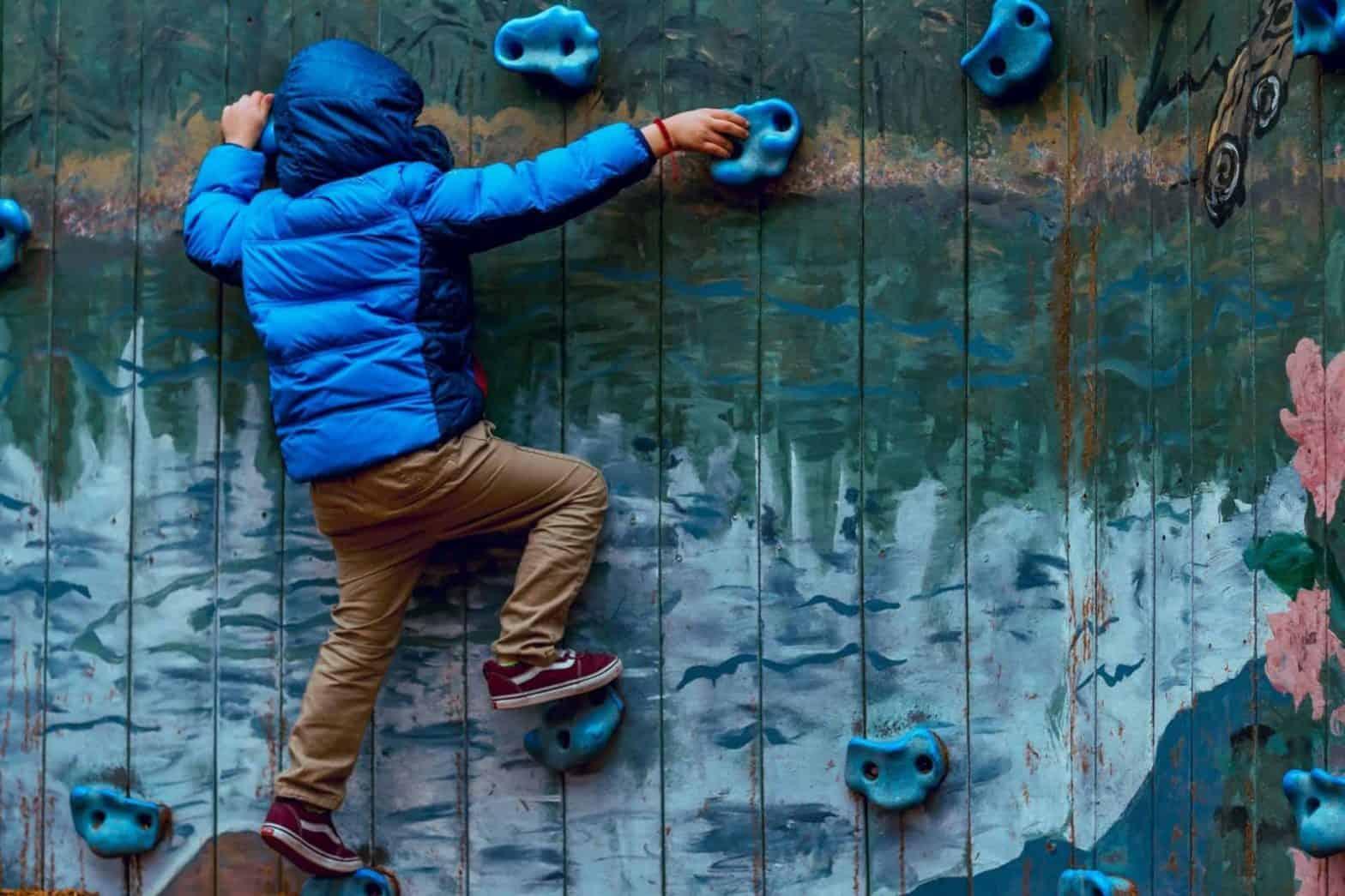 boy wall climbing